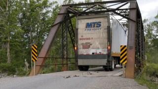 Too tall: Truck gets stuck on Axtell Bridge