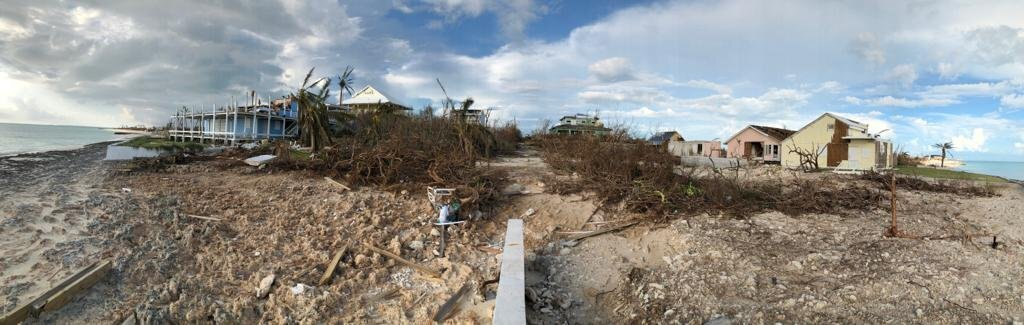 Photos: Man put son on roof for safety after Dorian hit and a storm surge swept away thechild