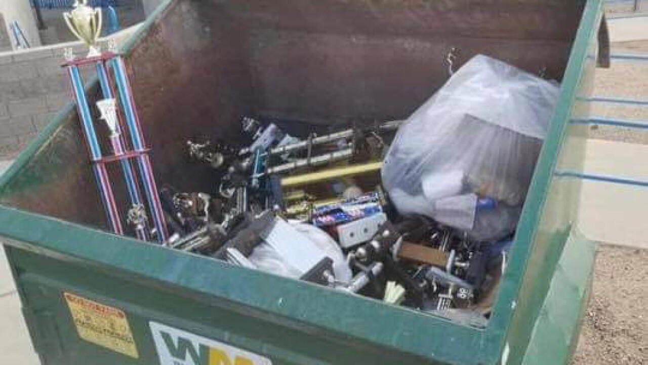 San Manuel high school sports trophies tossed in the trash