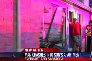 Suspected drunk driver reverses into son's apartment