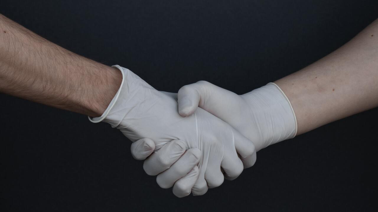 people-shaking-hands-in-latex-gloves-3959482.jpg