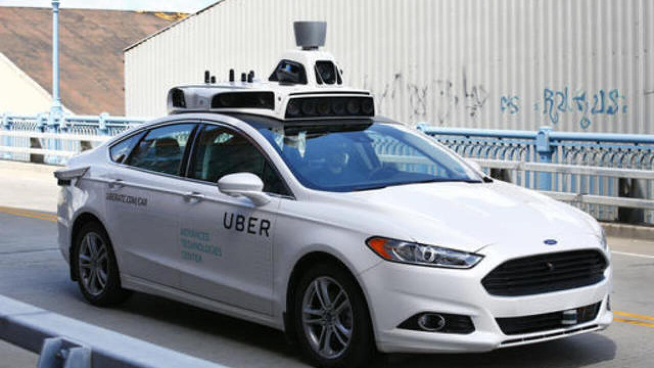 Uber offers rides in Pittsburgh as self-driving cars go public