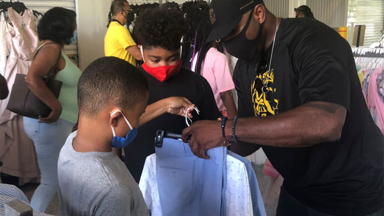 Ray Lewis held clothing giveaway for Baltimore area youth.jpg