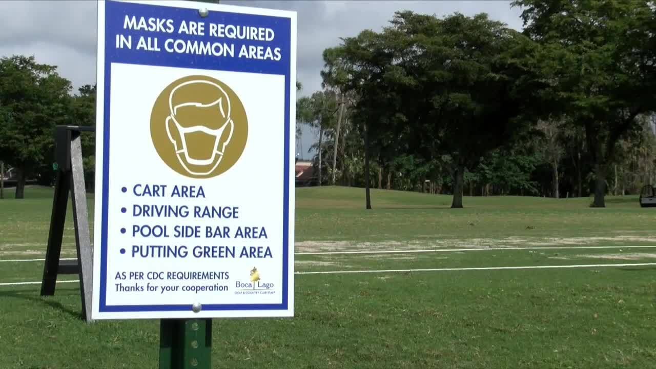 'Masks are required in all common areas' sign at Boca Lago Golf & Country Club