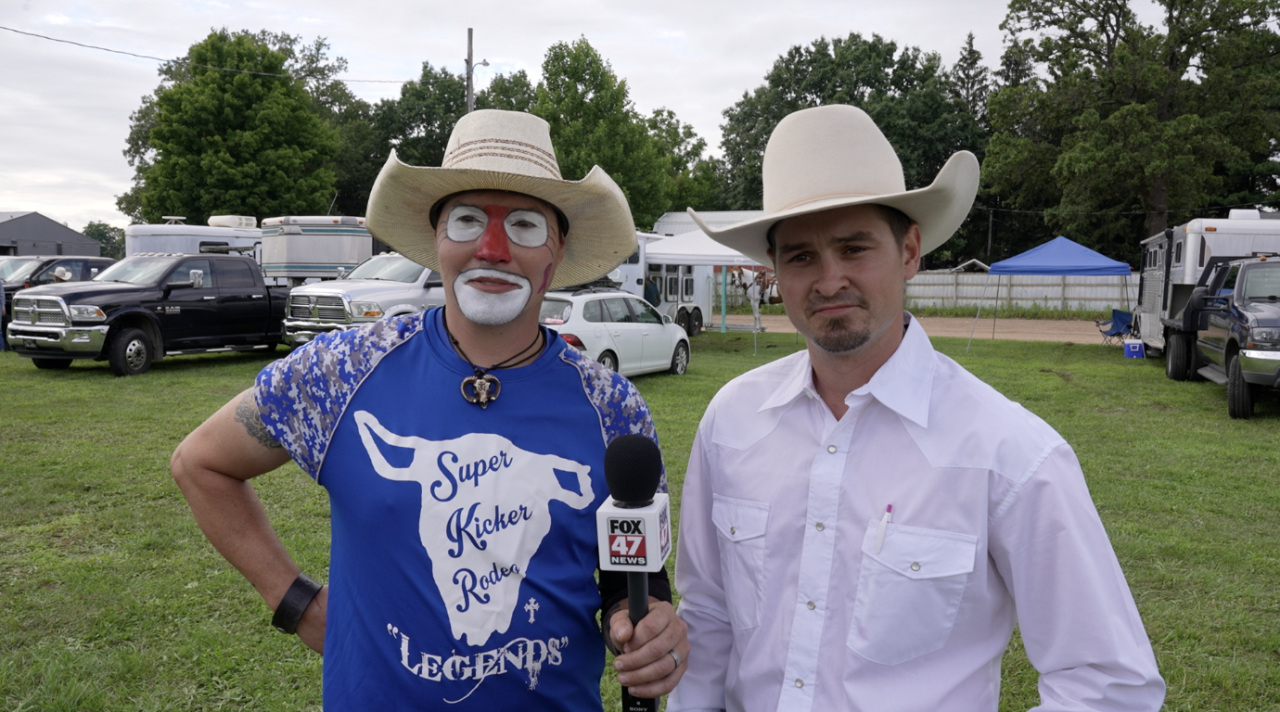The rodeo clown and announcer