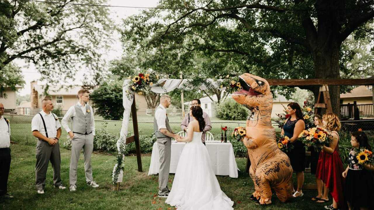 Maid of honor wears T.rex costume in Omaha wedding