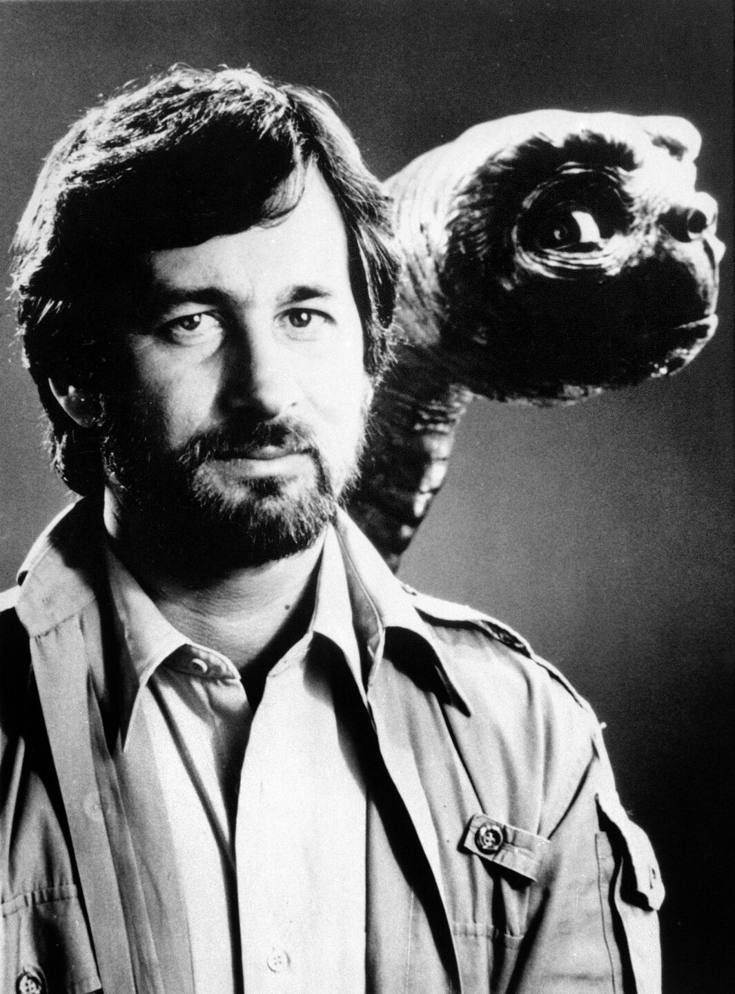 Steven Spielberg poses with E.T. in 1982