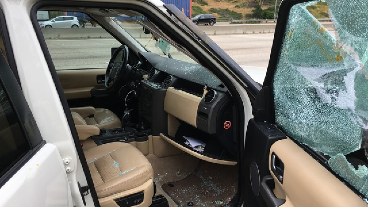 Flying plywood collides with vehicle on I-805