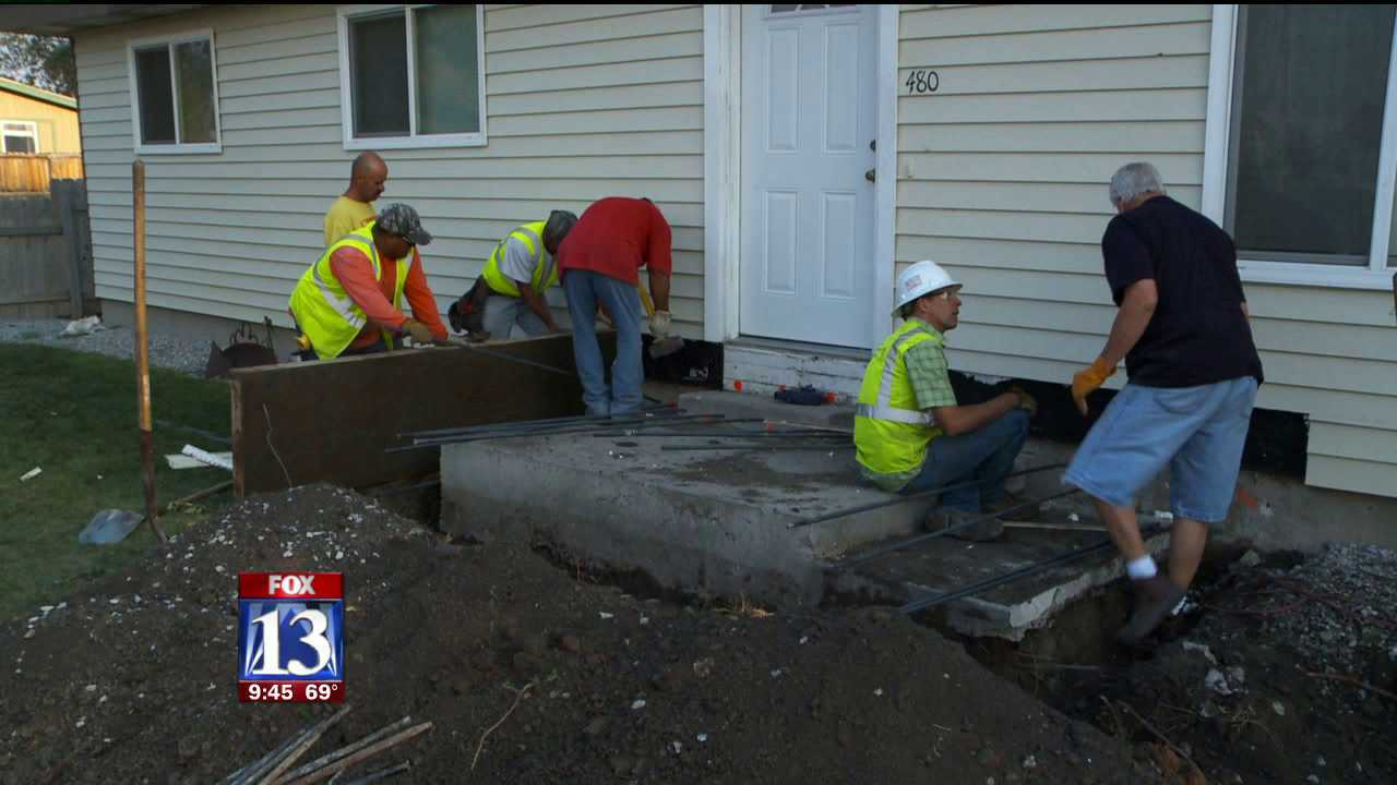 Co-workers help make injured man's home wheelchair ready