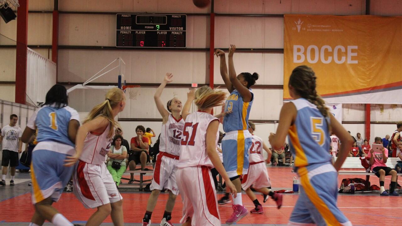 Olivia playing basketball