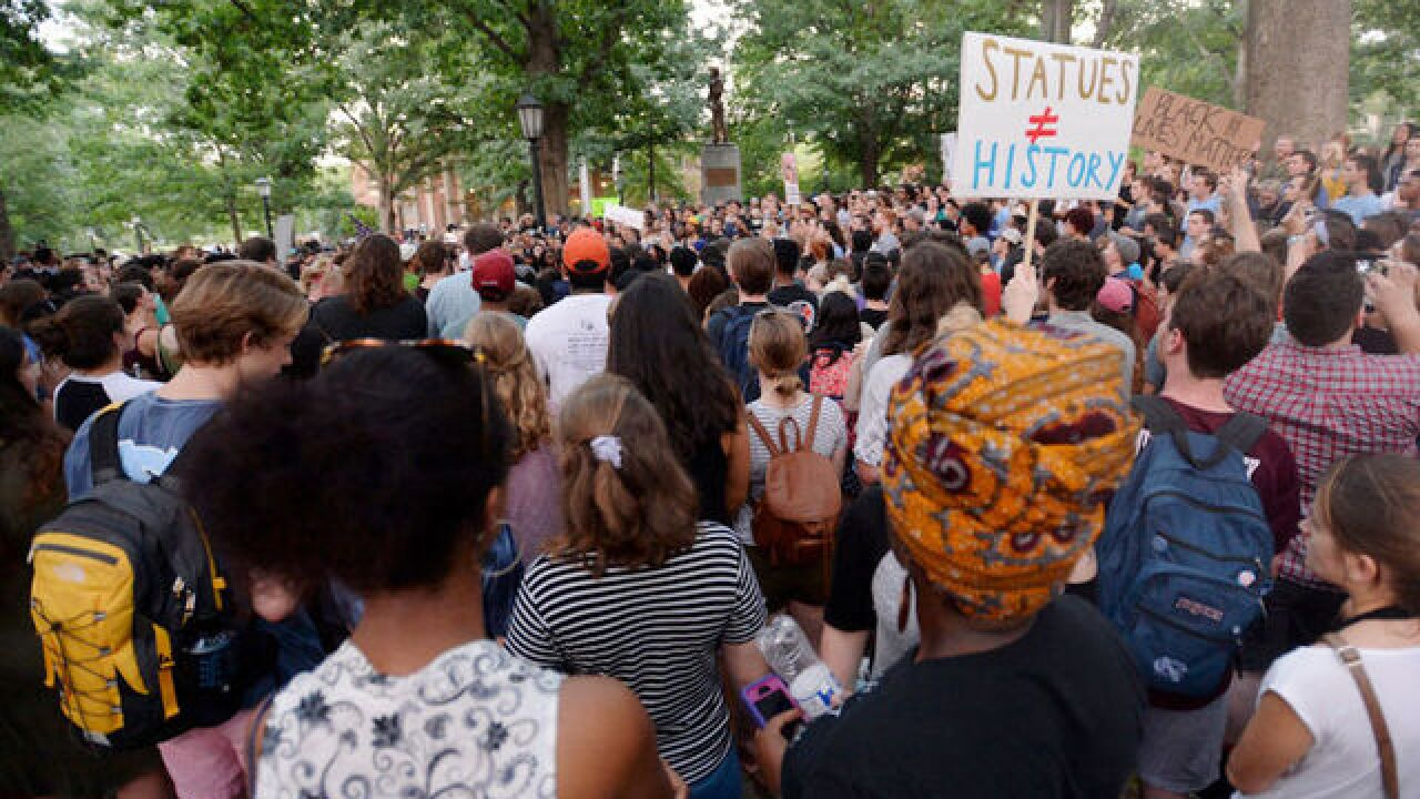Crowd of 250 protesters knocks over controversial Silent Sam Confederate statue