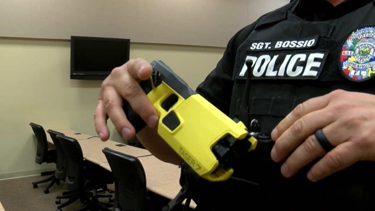 Sgt. Brian Bossio with the Stuart Police Department displays his department-issued Taser.jpg