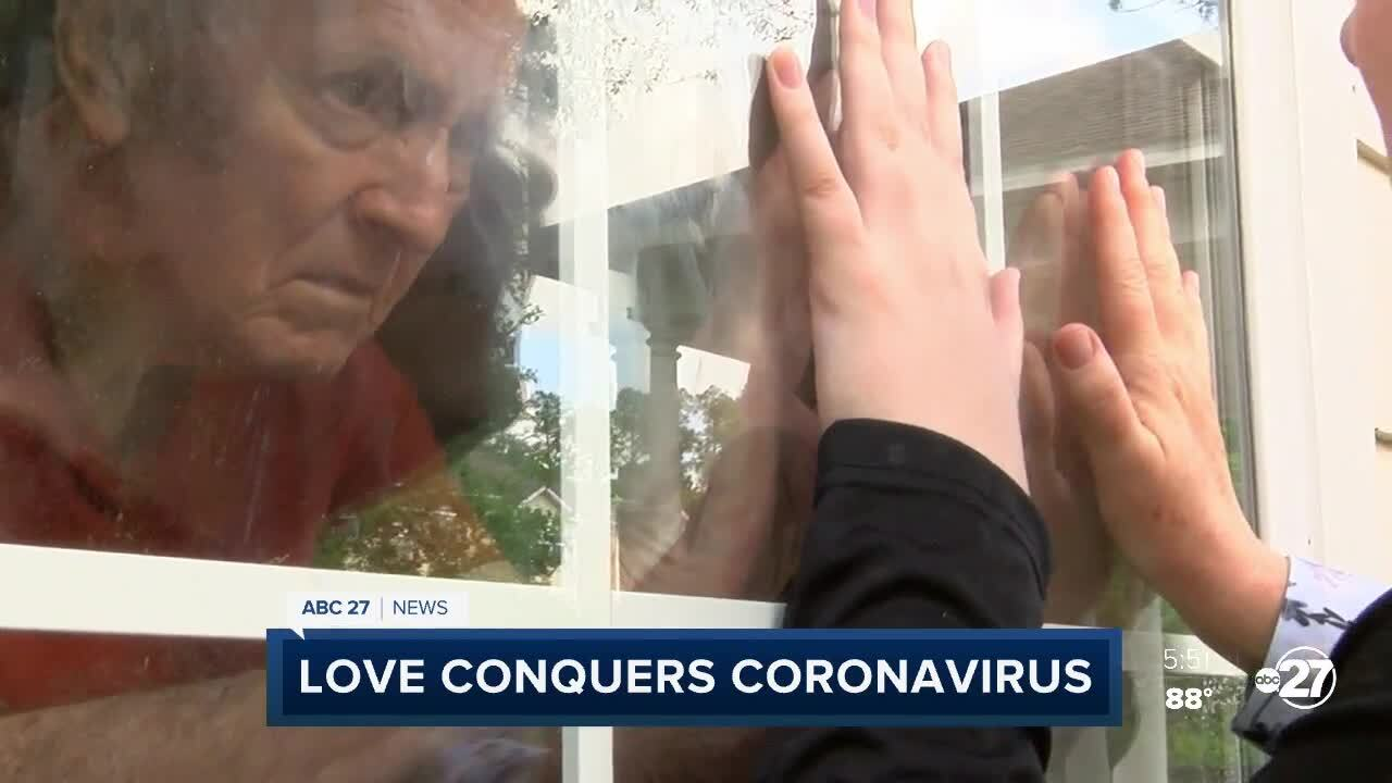 "Thomas and Sarah Jaye ""touch hands"" through the window since coronavirus keeps them apart."