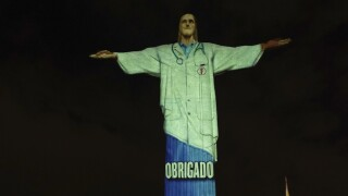 Rio's famous 'Christ the Redeemer' statue transformed into medical worker on Easter