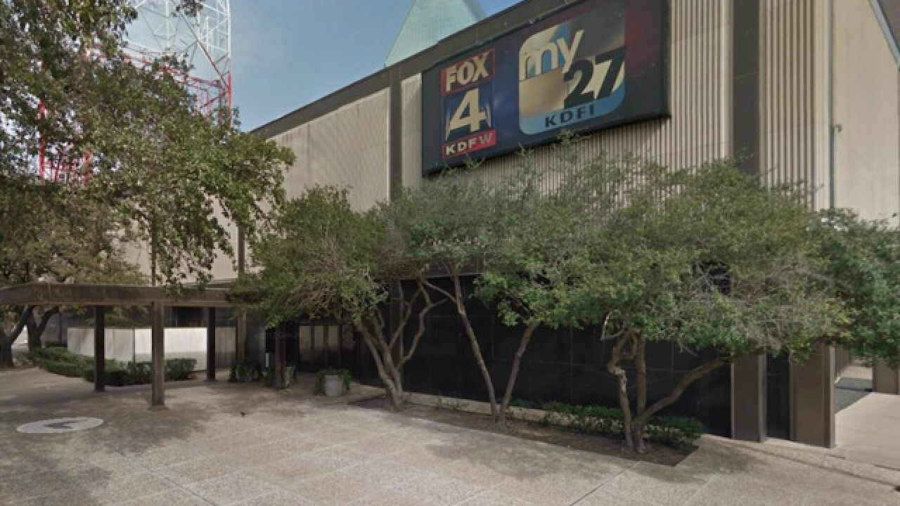 Man crashes truck into local news studio in Dallas