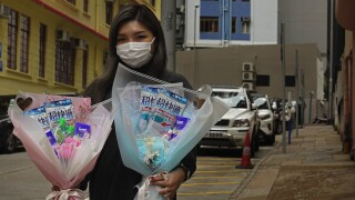 China reports another sharp rise in coronavirus cases after change in how cases are counted