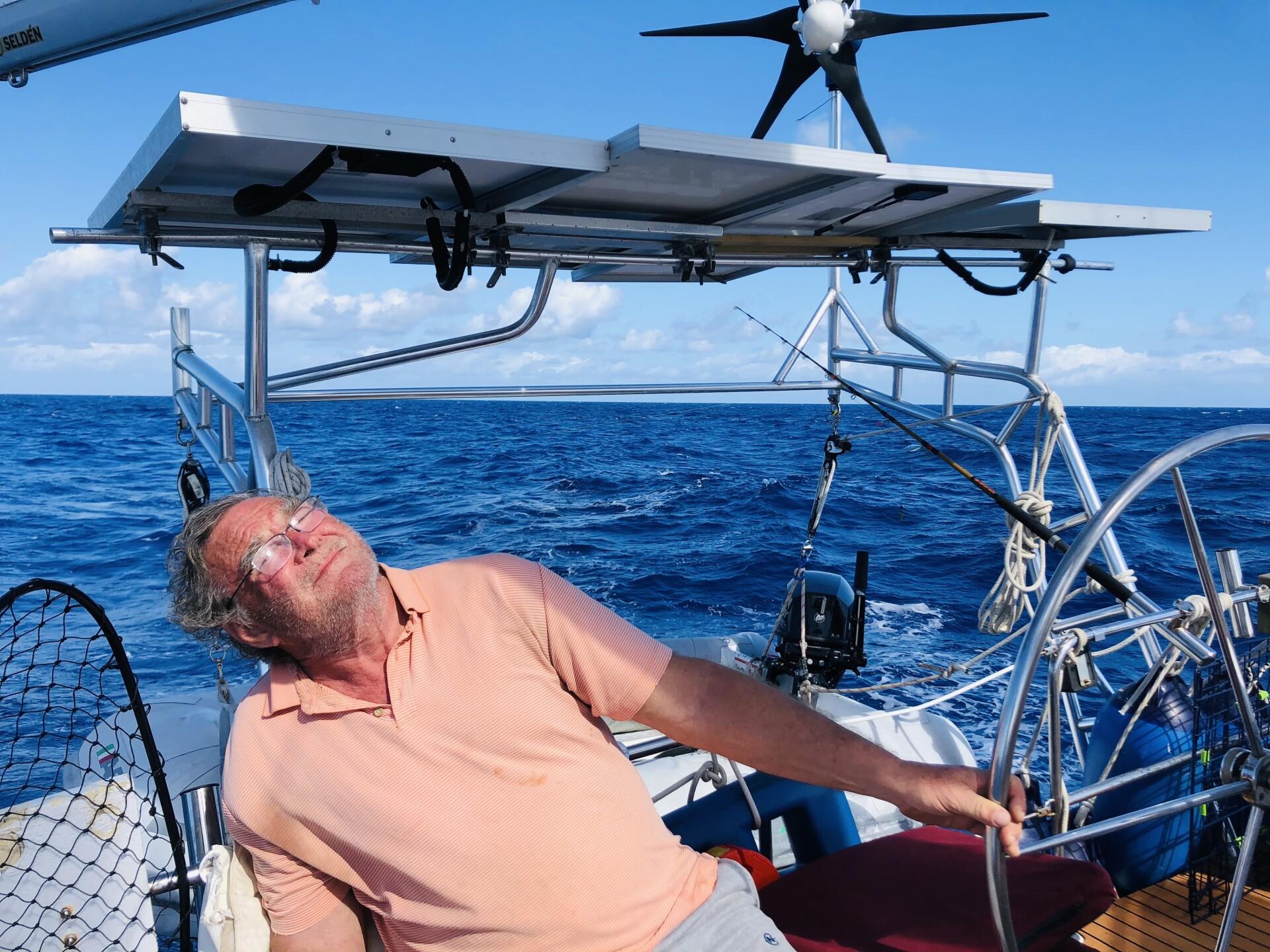 Sven Karrlson soaks up sun on sailboat