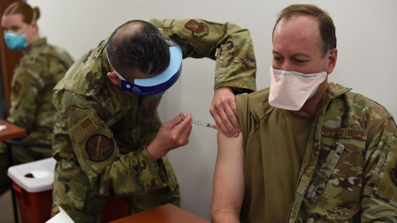 Col. Mark Pomerinke, 341st Medical Group commander, receives the first round of COVID-19 vaccinations given to medical personnel and first responders.