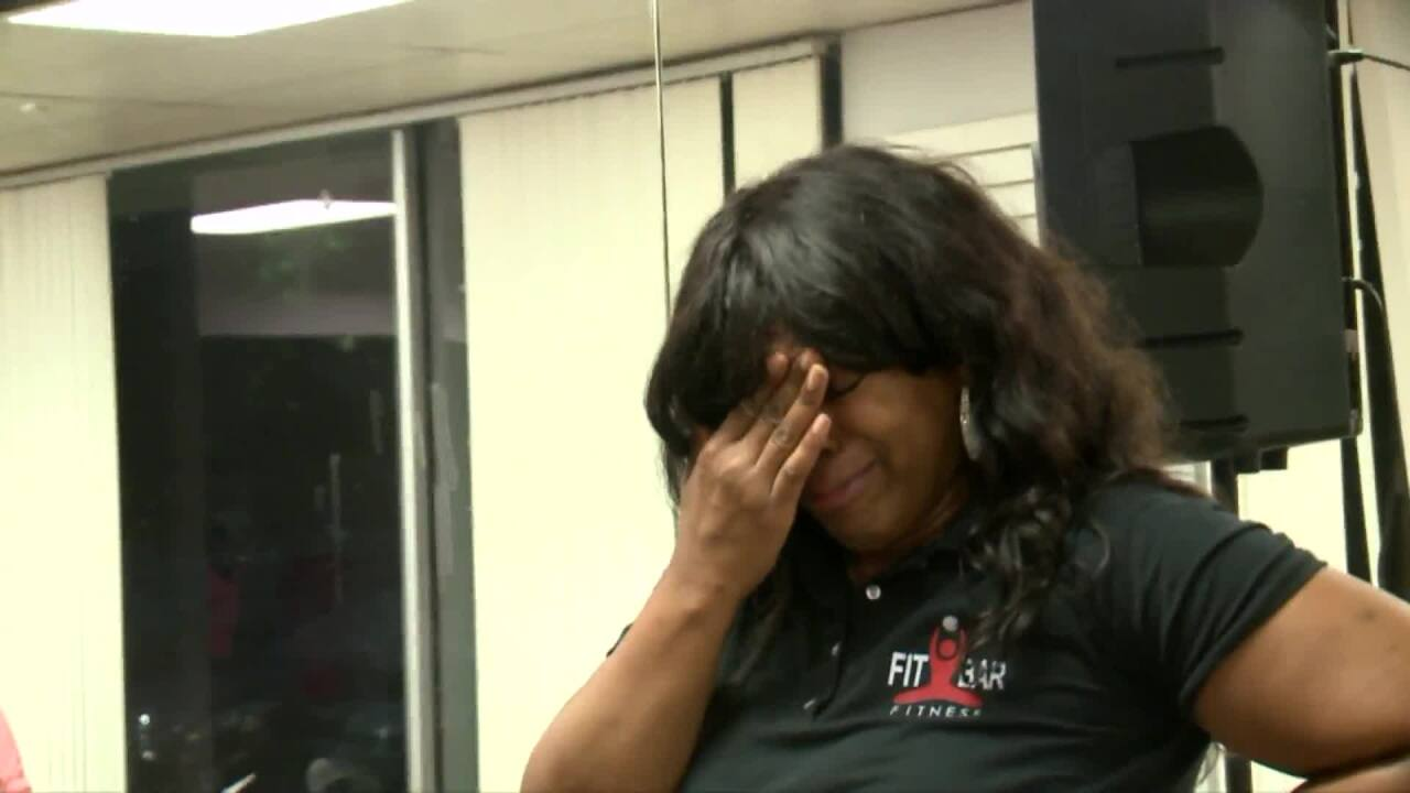 People Taking Action: Local fitness club owner fights back tears when surprised with award!