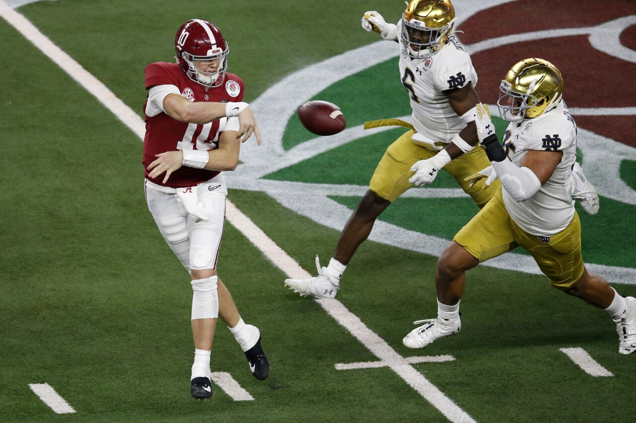 Alabama Crimson Tide QB Mac Jones throws under pressure from Notre Dame Fighting Irish in College Football Playoff semifinal at Rose Bowl