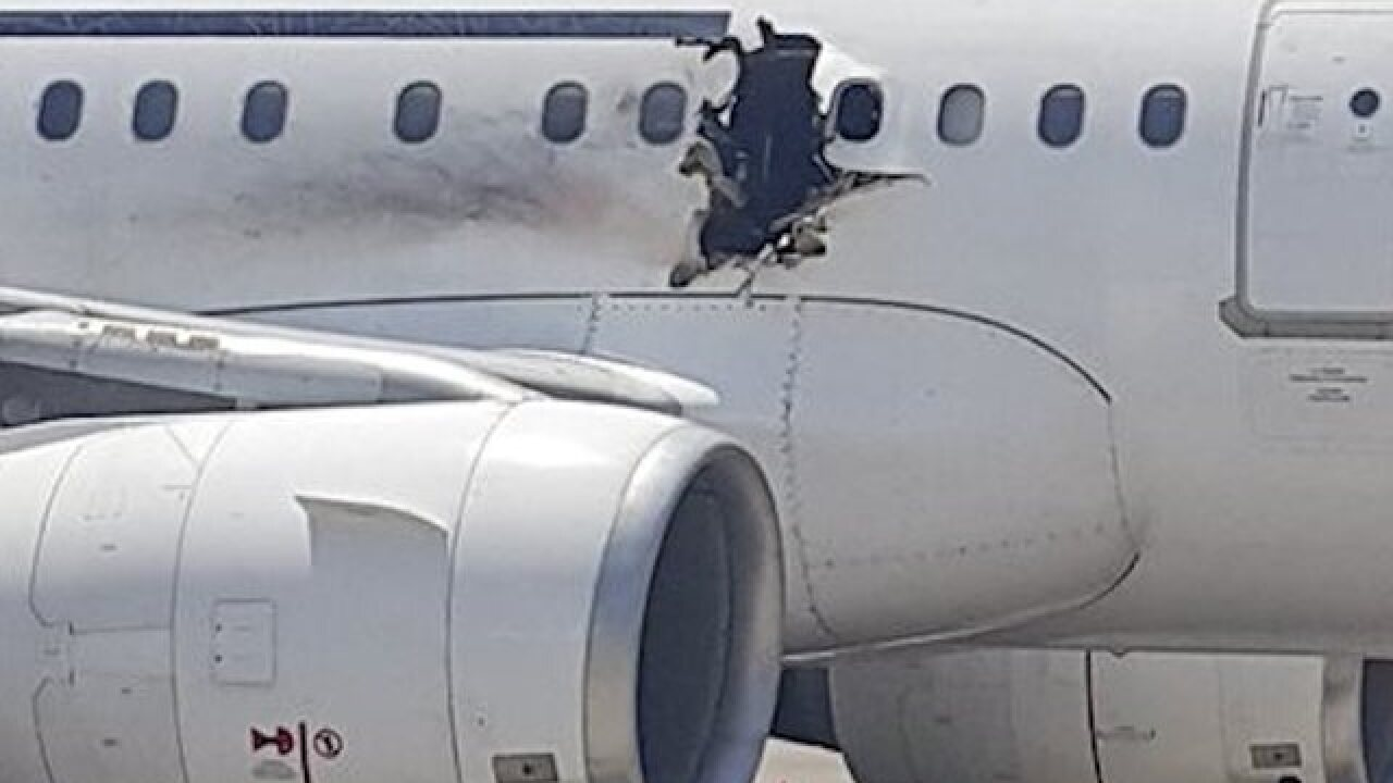 Pilot of plane hit by explosion describes scene