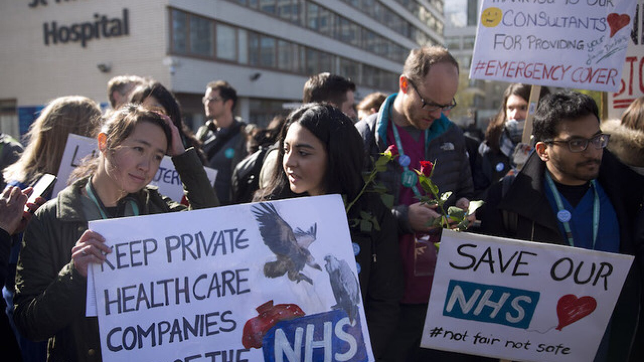 Thousands of UK doctors walk off job in strike