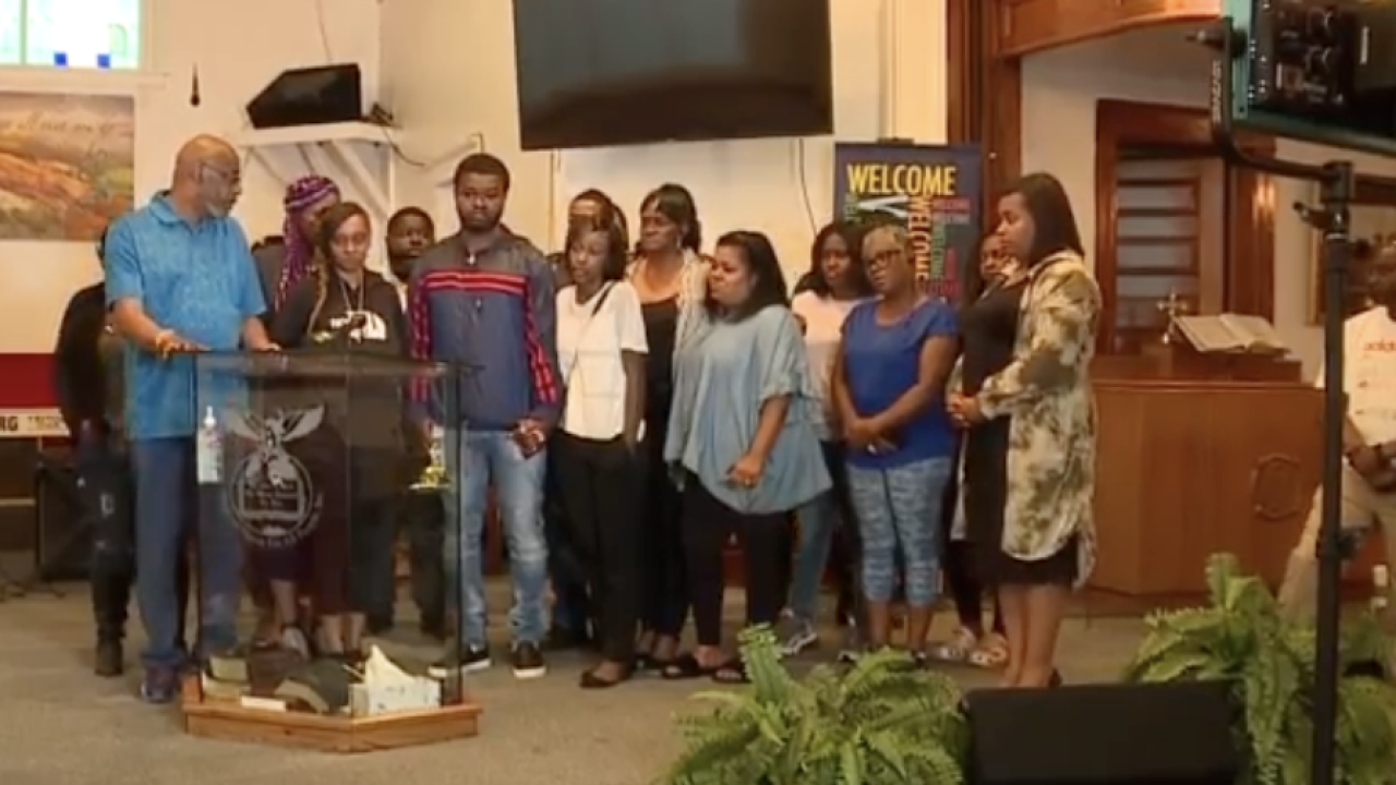 Family of Na'Kia Crawford gathers at House Of Prayer For All People Church in Akron.
