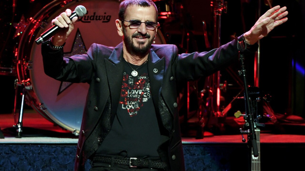 Beatles drummer Ringo Starr is knighted at Buckingham Palace