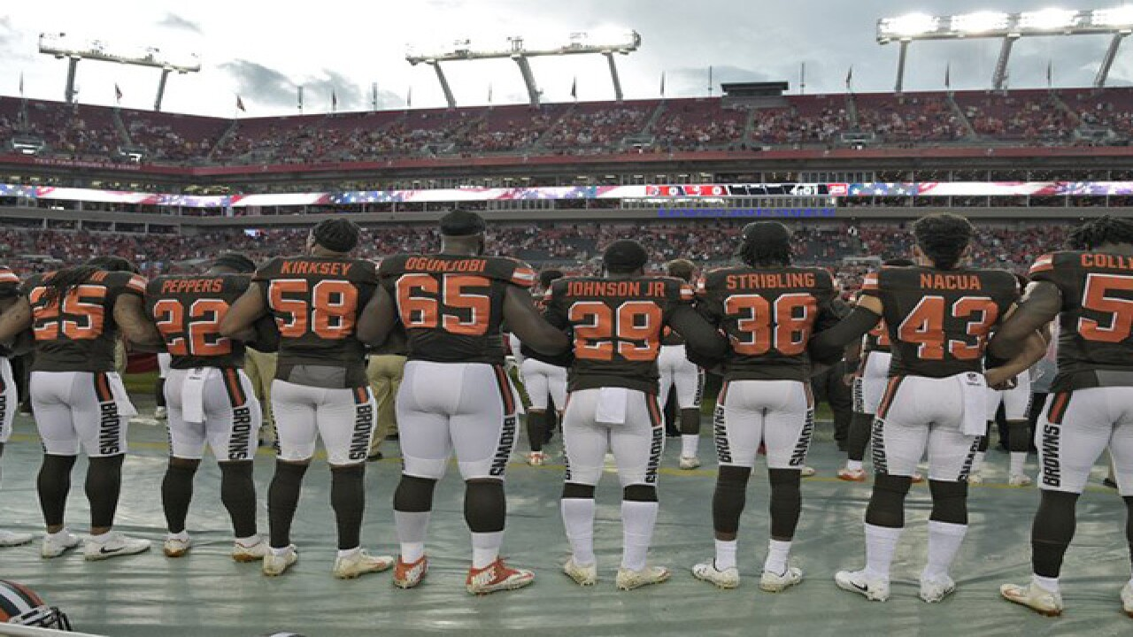 Browns players stand arm-to-arm during anthem