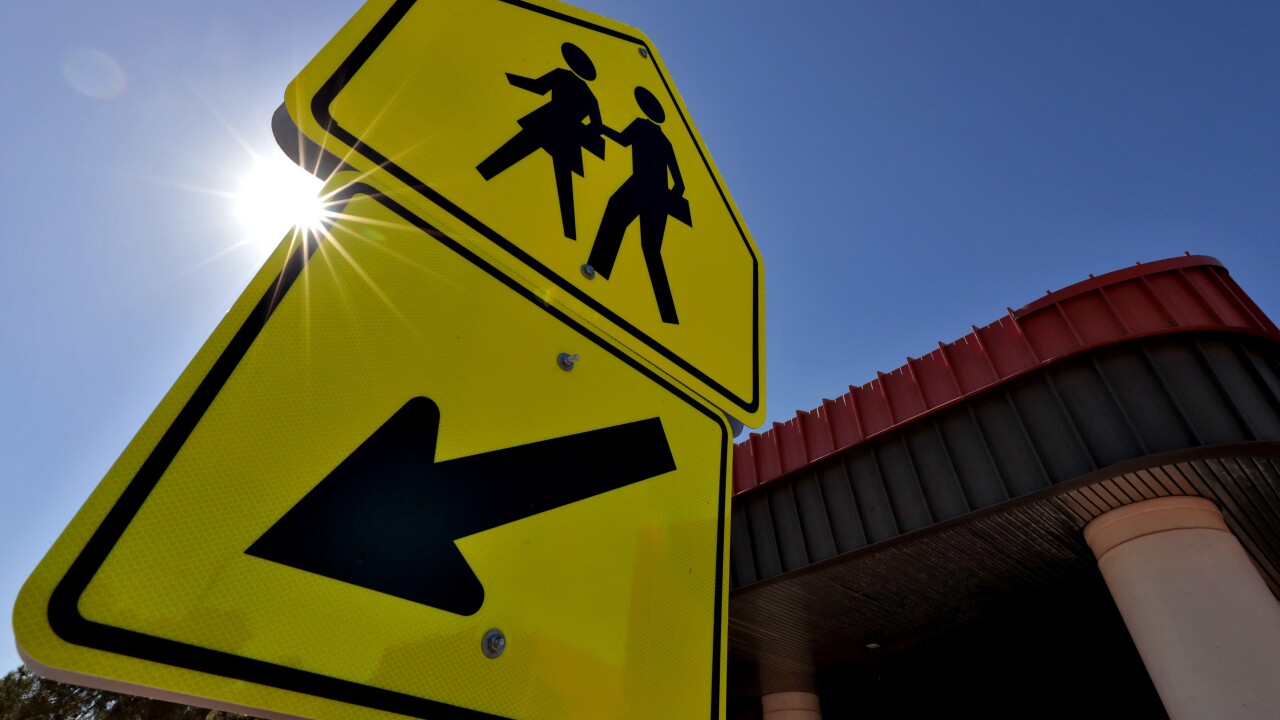 SCHOOL SIGN/ASSOCIATED PRESS