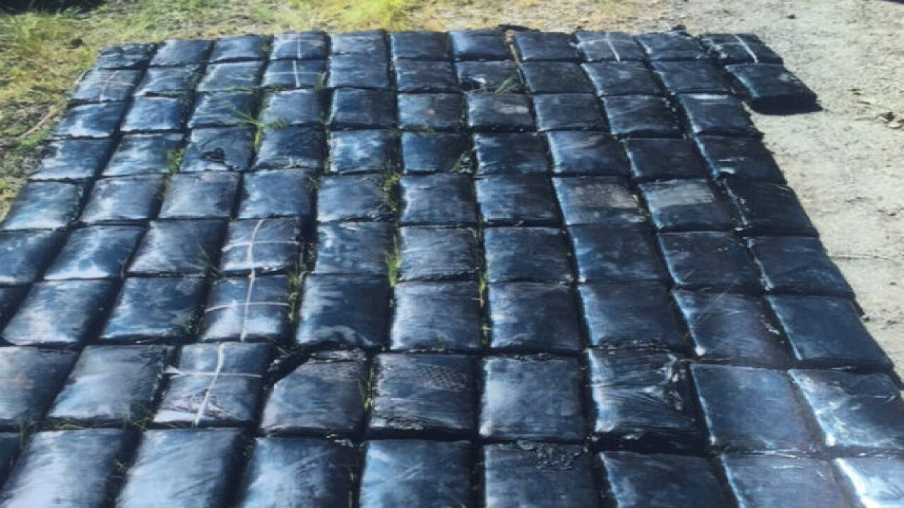 Hundreds of pounds of cocaine seized, 2 charged