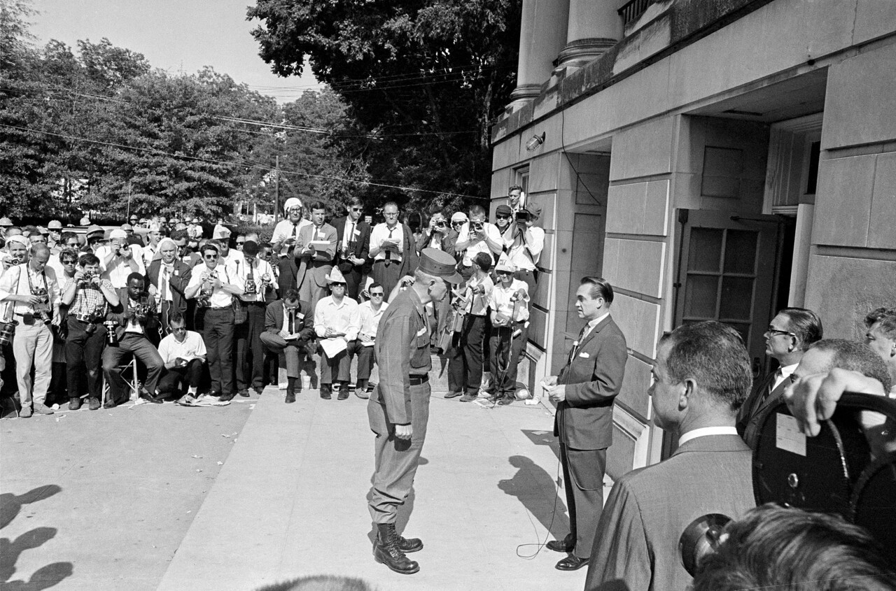 In this June 11, 1963 photo, National Guard Brig. Gen. Henry Graham informs Gov. George Wallace, right, that the guard is under federal control as the two meet at the door of Foster Auditorium at the University of Alabama in Tuscaloosa, Ala. Recent flaps over racially offensive language at the University of Alabama fit a pattern that's dogged the state's flagship school since it was integrated: Missteps along the path to greater diversity and inclusion often make more of an impression than positive strides do.(AP Photo)