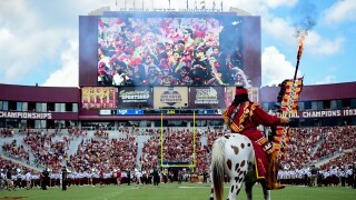Chief Osceola and Renegade on Bobby Bowden Field at Doak S. Campbell Stadium before Florida State Seminoles football game