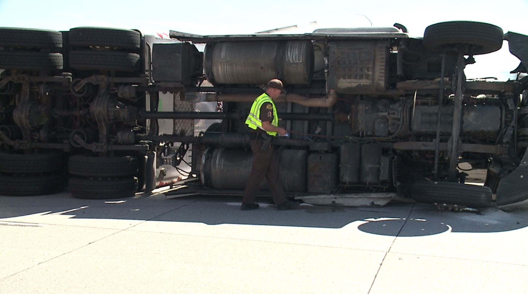 Photos: Truck tips over on sharp curve enteringI-80