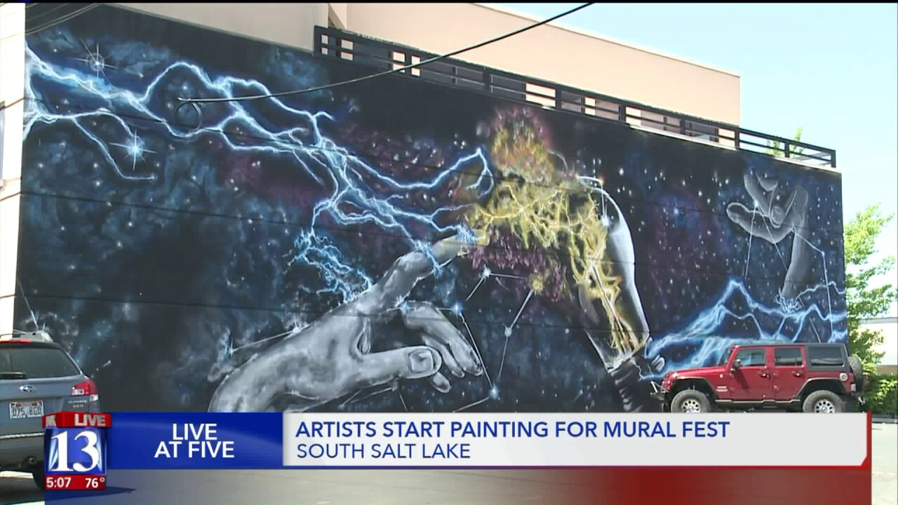 Commissioned artists painting parts of South Salt Lake for Mural Fest2019