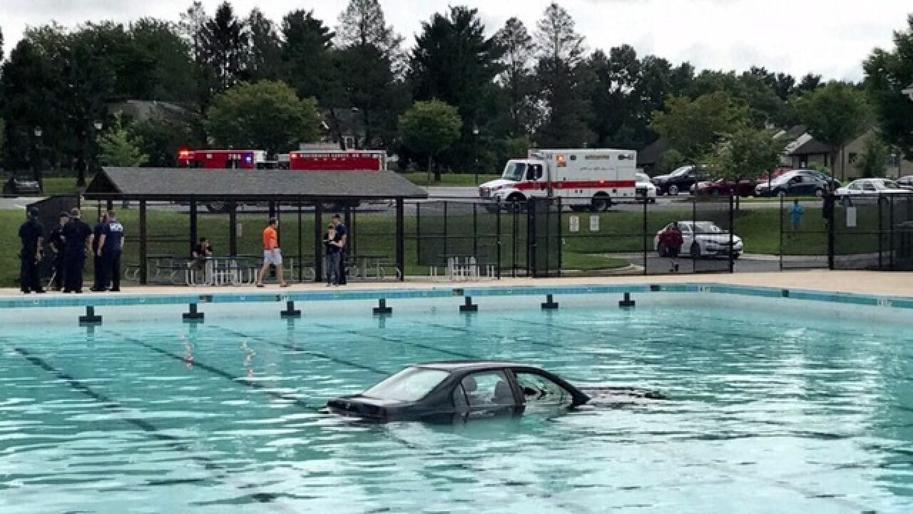 Driving lesson ends with car landing in a Maryland swimming pool