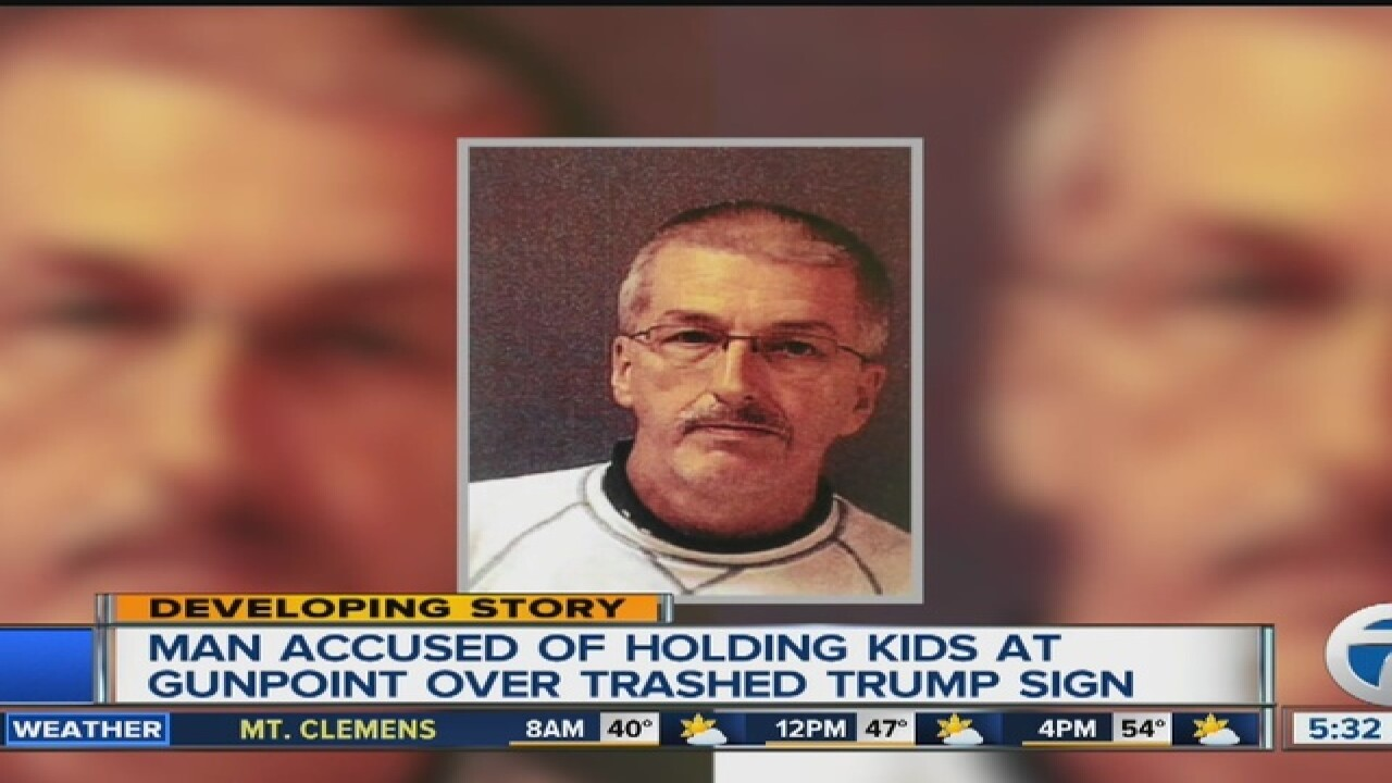 Man allegedly holds kids at gunpoint over Trump lawn sign