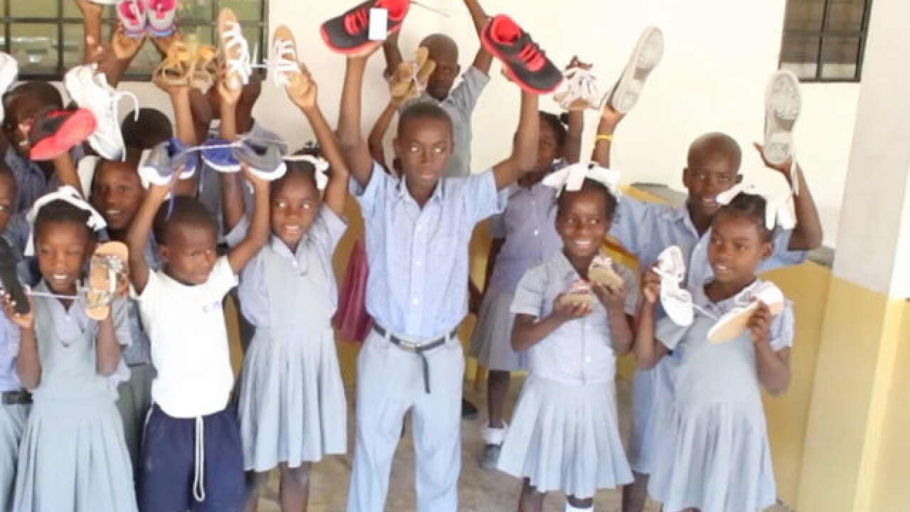 Young girls collect shoes for people in Haiti