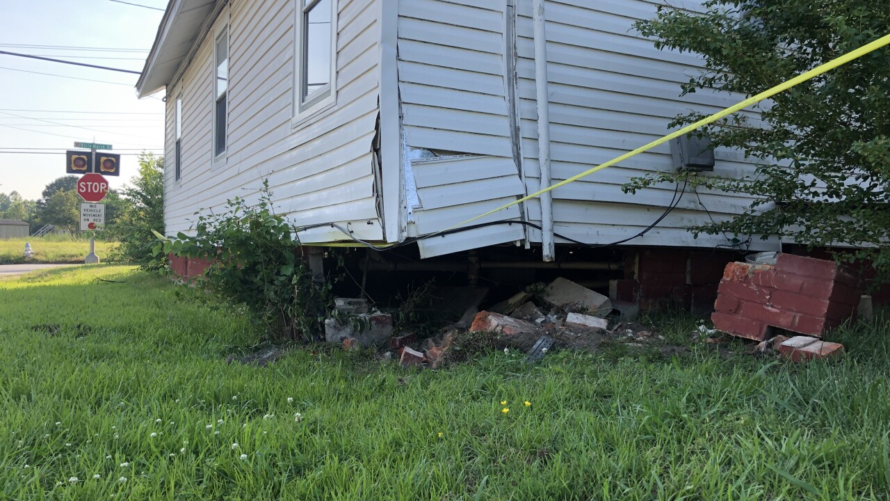 Woman crashes vehicle into Suffolk residence