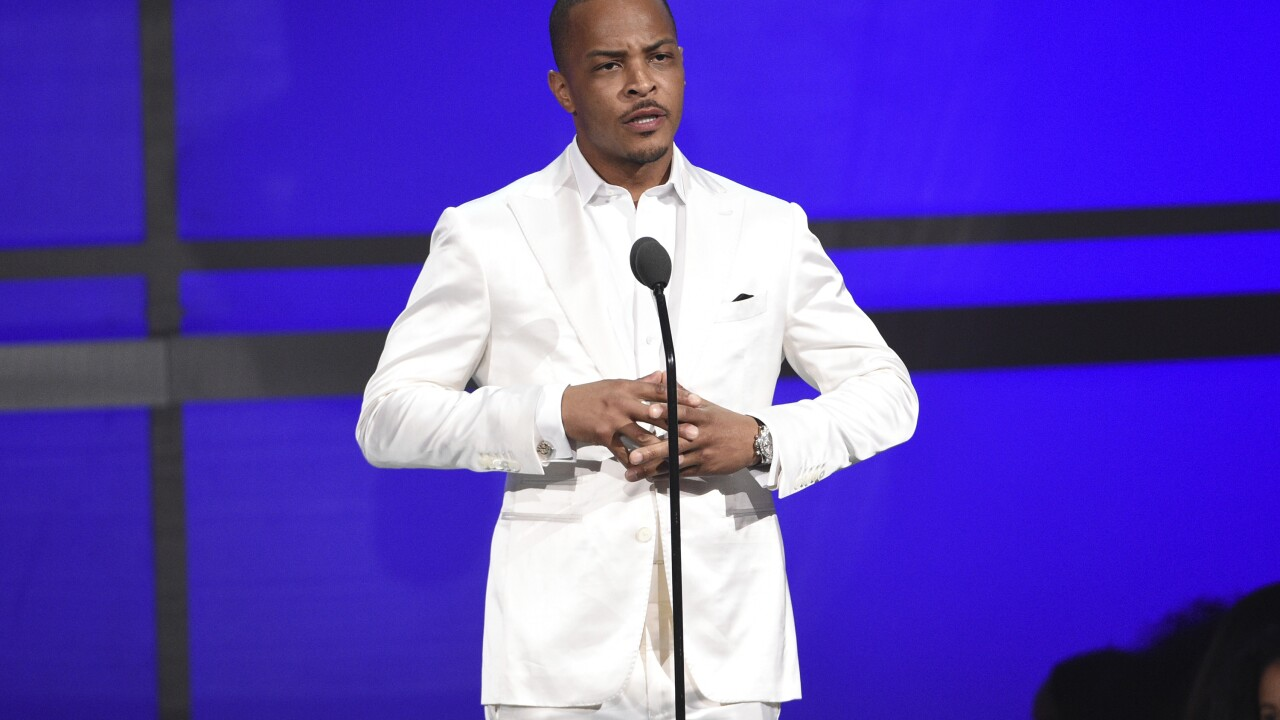 Musician T.I. fined in securities investigation