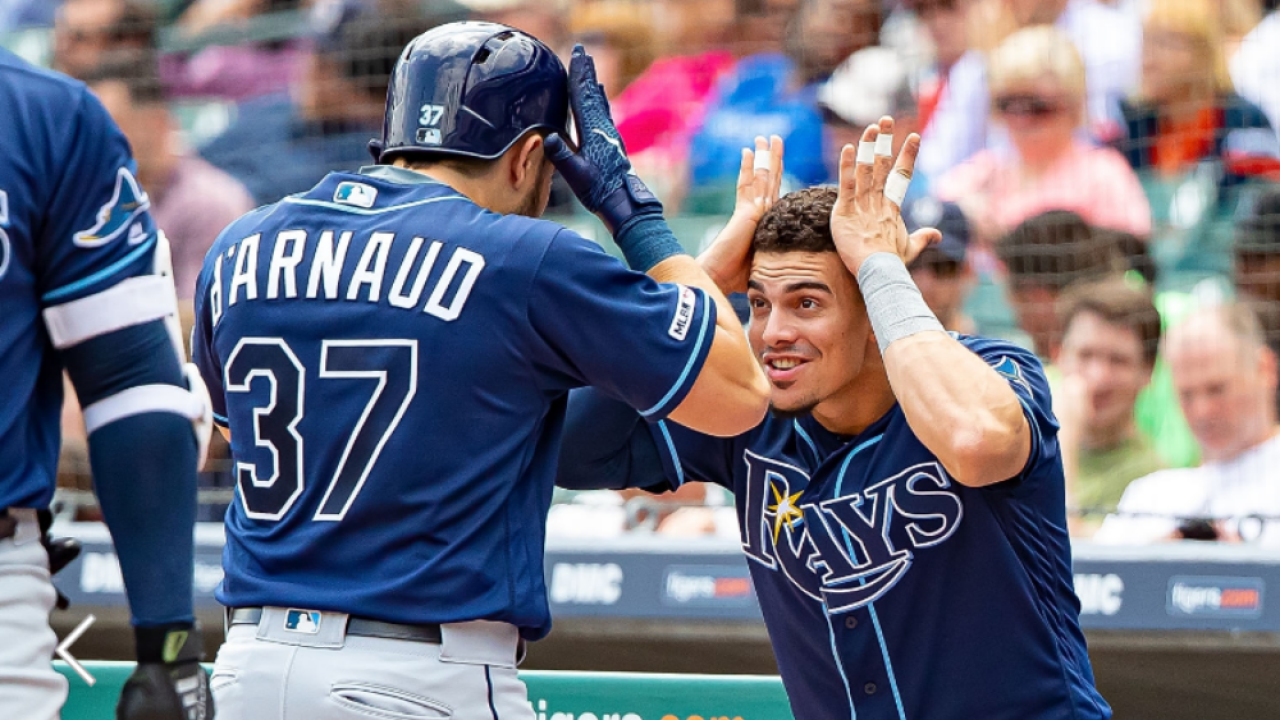Travis d'Arnaud celebrates with Willy Adames