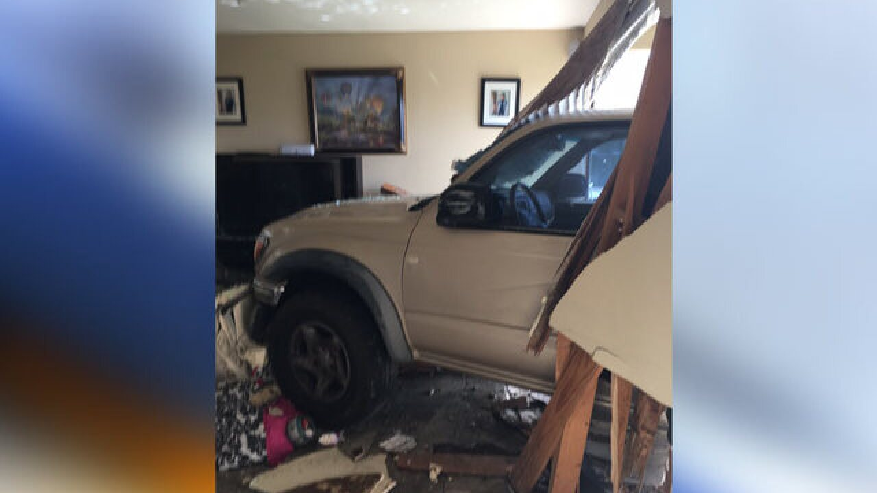 Police: Burglary suspect crashes truck into home
