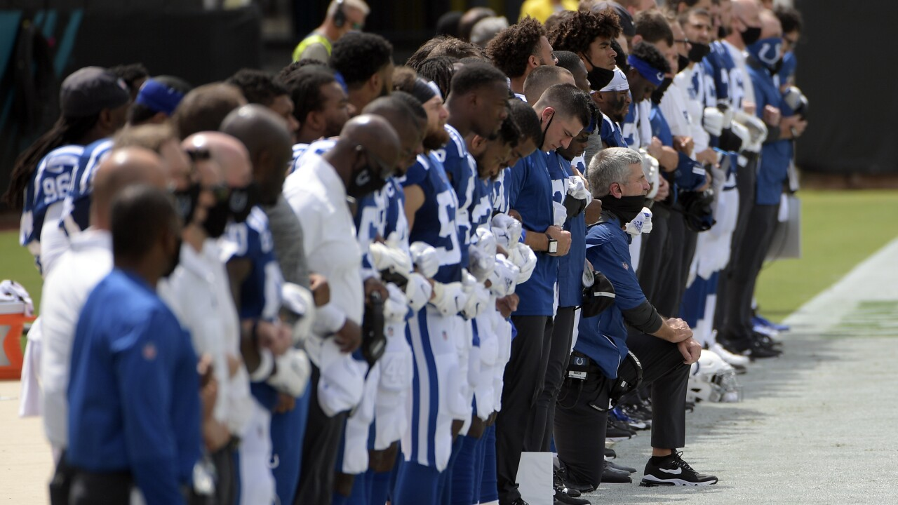 Colts head coach kneels, players link arms before opening game against Jaguars