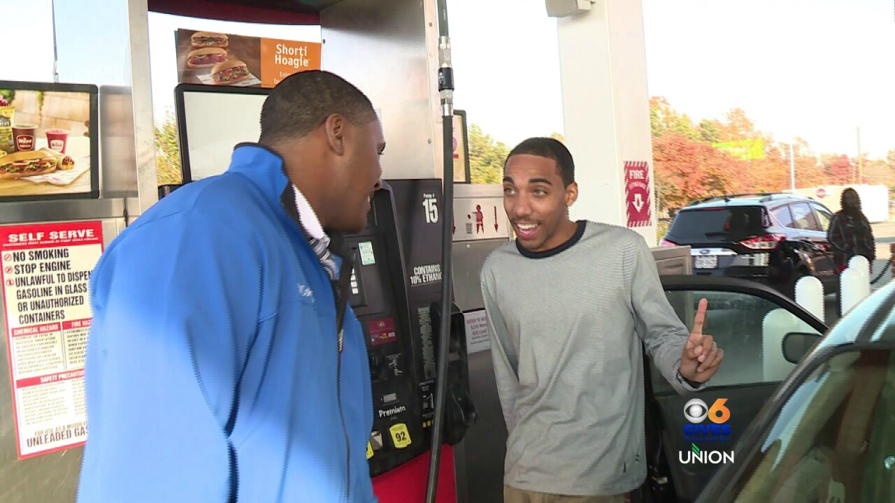 Fill'er up! Rob pumps 'free gas' during the Month ofGiving