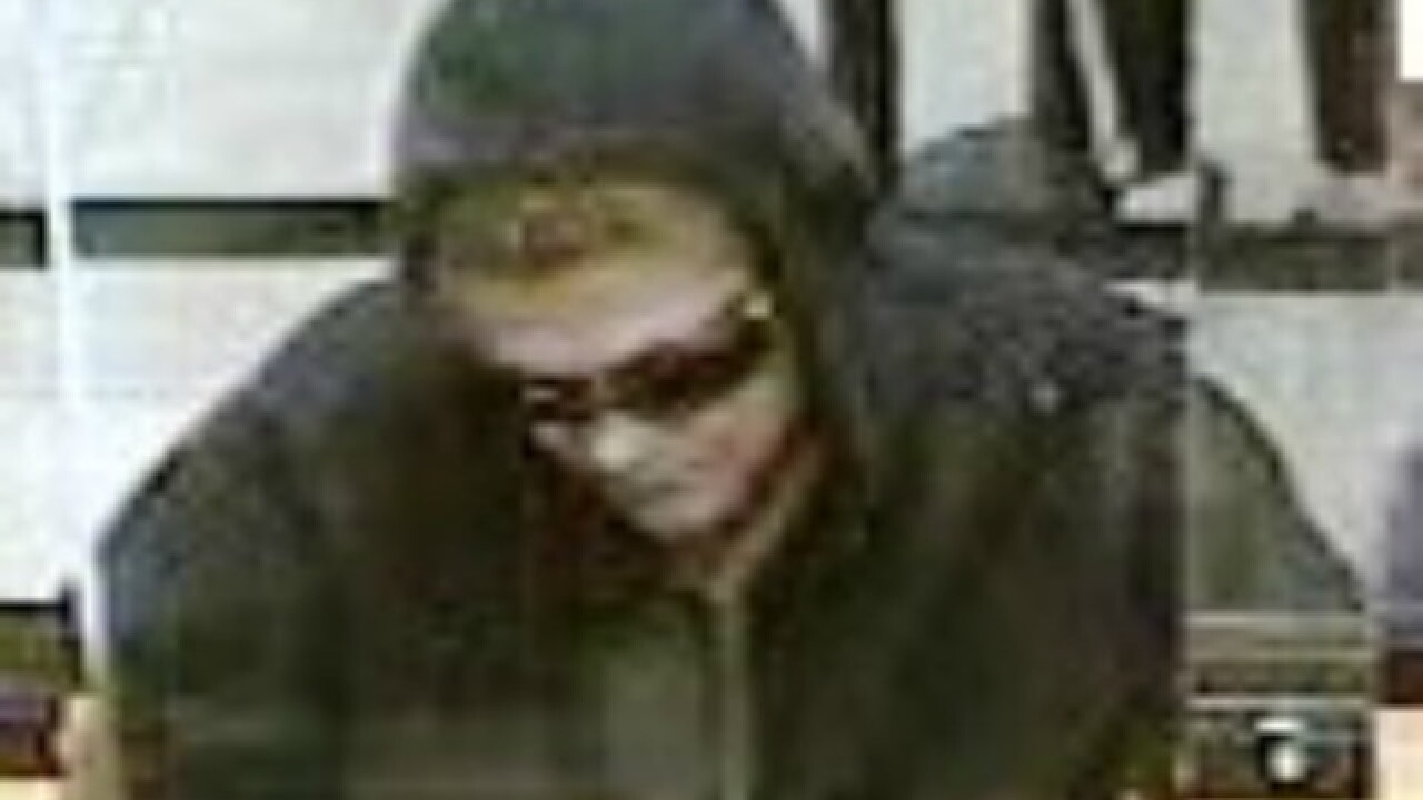 Surveillance photos show alleged bank robber