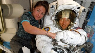 In this image released Friday, Oct. 4, 2019, by NASA, astronauts Christina Koch, right, and, Jessica Meir pose for a photo on the International Space Station. NASA has moved up the first all-female spacewalk to Thursday, Oct. 17, 2019, or Friday because of a power system failure at the International Space Station.