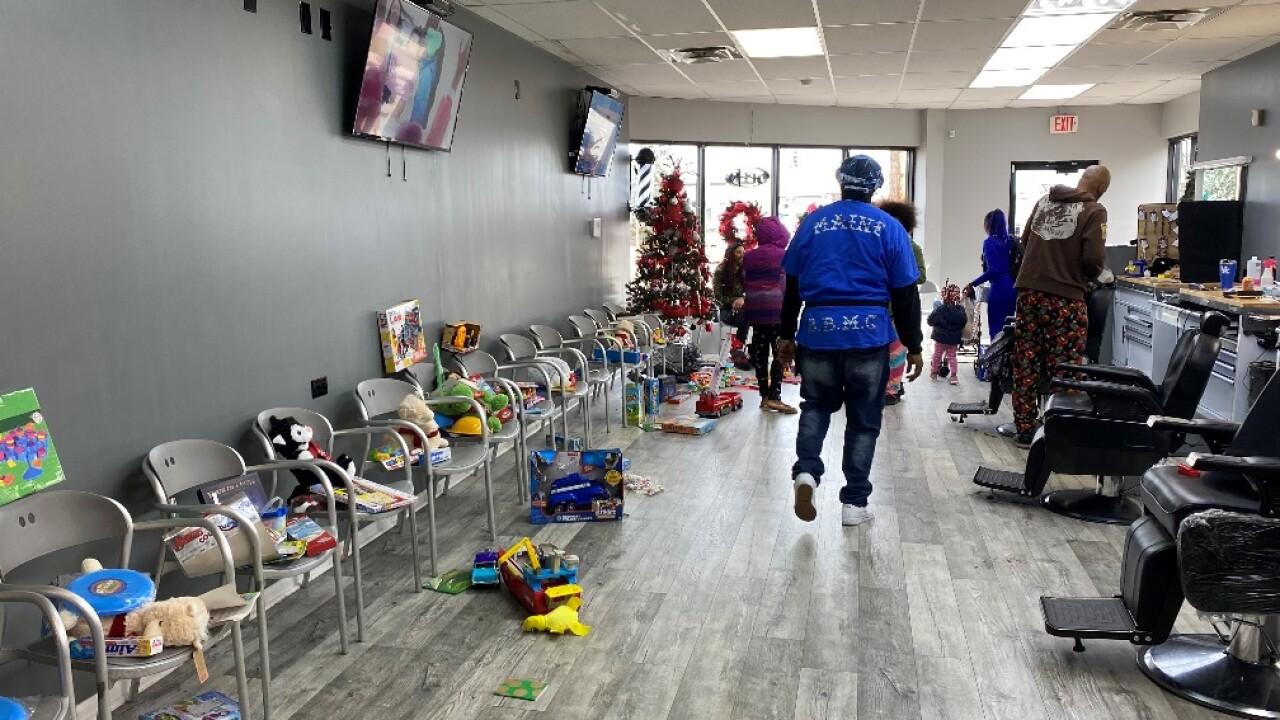 Plush Cuts Barbershop in Hamilton holds toy drive.jpg