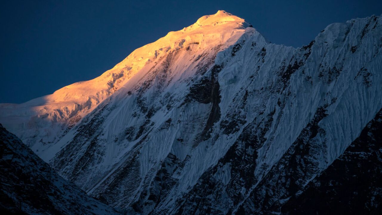 Rescue team finds buried backpack in hunt for 8 missing in Himalayas