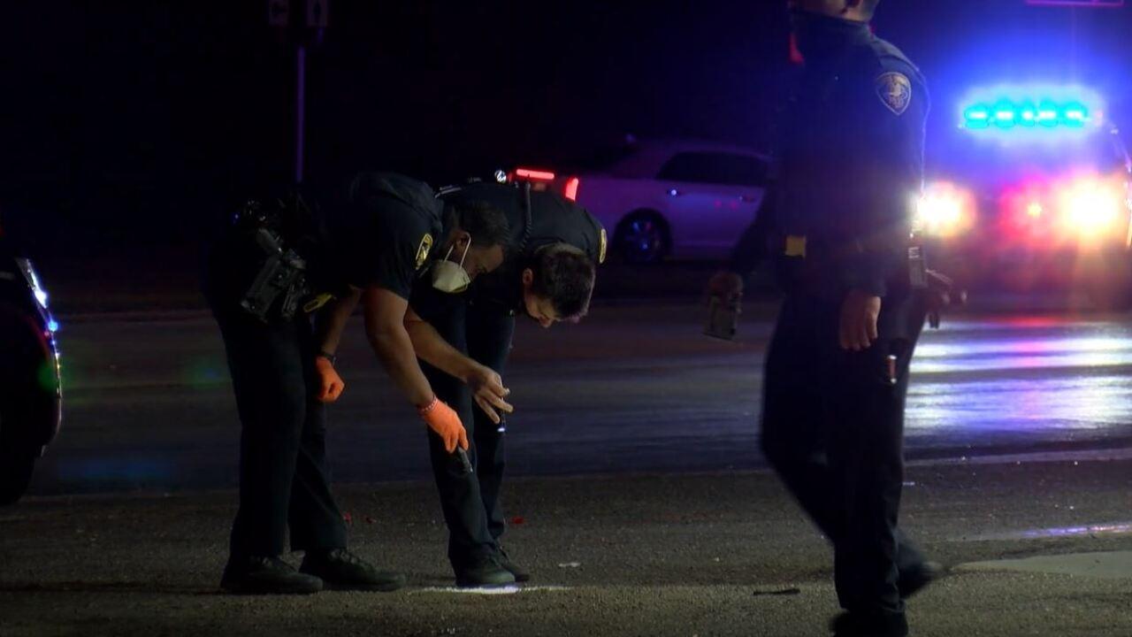 ccpd officers examine crime scene.JPG