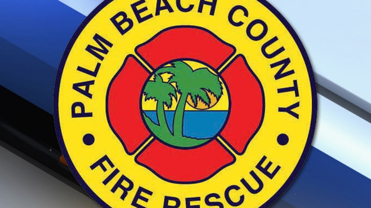 Palm Beach County Fire Rescue working on downed power lines